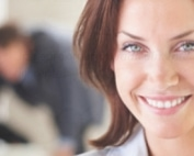 Blur image of a confident business woman with her colleagues at the back